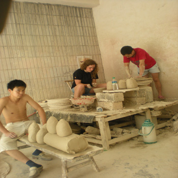 Student in China making Ceramics with Chinese